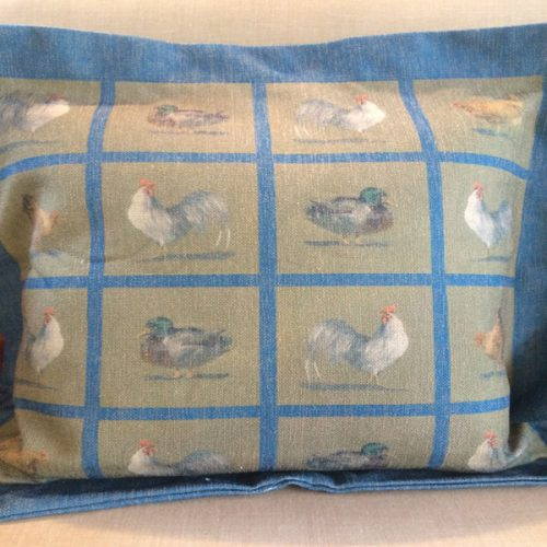 Square Chicken cushion by Blue Guinea in blue.