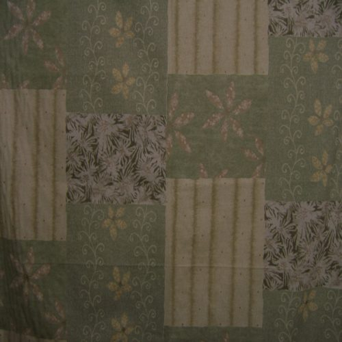 Patchwork fabric featuring floral and stripe patches